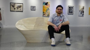 """Walter Mingledorff, a senior industrial design major specializing in furniture design, with his """"Best in Show"""" lounger, """"I Lost my Multi-tool from Tupelo."""" Photo submitted"""